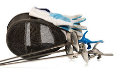 Fencing Foil Equipment Isolated on White. Fencing foil equipment. Three fencing foils with pistol grip (sporting weapon), a fencing mask and a blue and white Royalty Free Stock Photos