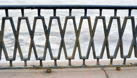 Fencing fragment on the embankment against the river covered wit Stock Photo