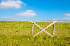 Fencing at grassy dike Stock Image