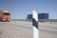 Fencing of the highway On a blurred background cars royalty free stock photo