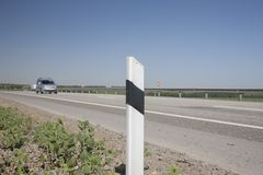 Fencing of the highway On a blurred background cars stock images