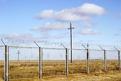 Fencing. Industrial facility in the steppe Royalty Free Stock Photography