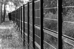 Fencing made of metal mesh to protect Royalty Free Stock Images