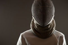 Fencing mask. Studio portrait of fencing athlete wearing face protective mask, copy space stock images