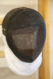 Fencing mask with the traditional fine wire mesh Stock Photo
