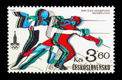 Fencing, Olympic Games 1980 - Moscow serie, circa 1980. MOSCOW, RUSSIA - NOVEMBER 25, 2017: A stamp printed in Czechoslovakia shows Fencing, Olympic Games 1980 Stock Photo