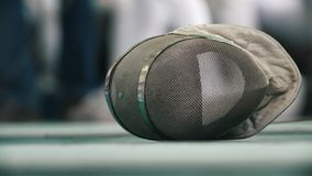 Fencing protective mask on the floor during sport tournament. Close up stock footage