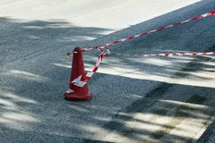 Fencing red and white tape, which prohibits movement. Warning, police tape. royalty free stock images