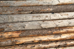 Fencing of roughly machined planks closeup Royalty Free Stock Image