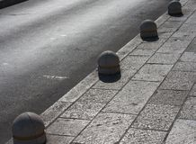 Fencing of the stone columns on the road Stock Photos