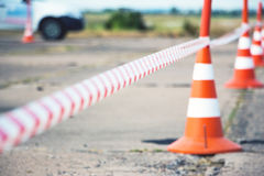 Fencing tape and road cone. Selective focus. Fencing tape and road cone Stock Photography