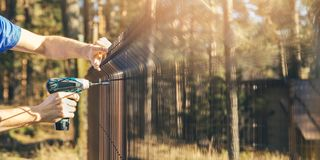 Free Fencing - Worker Installing Metal Wire Mesh Fence Panel Stock Photos - 144475393
