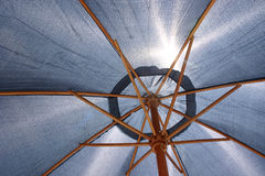 Fend off the Sun. Beach Umbrella fending off the hot summer sun Stock Photo
