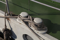 The fender. A fender on a boat and some rope to keep it safe in harbor Stock Image