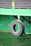 Tyre as fender on pier. Fender from old truck tyre on pier Stock Photography