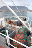 Fenders of Fishing Trawler. Fenders lie in the foreground as a fishing trawler enters Table Bay on it's way to Cape Town Stock Photos