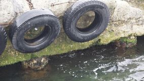 Fenders in harbor. Fenders made of old car tires in a harbor stock photos