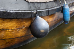 Fenders on a traditional wooden ship Stock Image