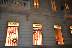 Fendi fashion boutique brightly illuminated windows. Royalty Free Stock Photography