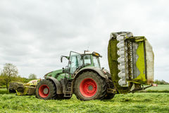 Fendt green tractor with claas mowers in silage field Royalty Free Stock Images