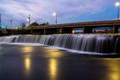 Fenelon Falls Prior To The Sunrise. Looking up the Fenelon River in the town of Fenelon Falls, Ontario, Canada prior sunrise. The river spans a distance of just stock photo