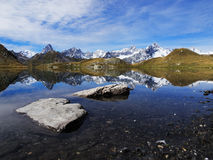 Fenetre Lake With Stones In Foreground. Fenetre Lake (Lac de Fenêtre in French) in Swiss alps with stones in Foreground with Mont Blanc, Grande Jorasses Royalty Free Stock Image