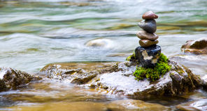Feng Shui balance. Round stones for meditation laying on rock Stock Image