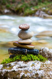Feng Shui balance. Round stones for meditation laying on rock Royalty Free Stock Photo