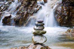 Feng Shui balance. Round stones for meditation laying on rock Royalty Free Stock Images
