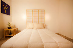 Feng Shui Bedroom. Luxurious simple Feng Shui minimalist and homely designed Japanese style bedroom Royalty Free Stock Image