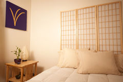 Feng Shui bedside table stock photography