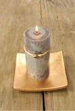 Feng Shui candle. On rustic wood Stock Photo