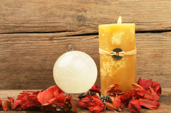 Feng shui candle and crystal ball. Burning feng shui candle, dried flowers and a crystal ball royalty free stock image
