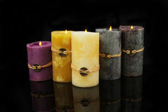 Feng Shui candles with reflections on black Royalty Free Stock Photography