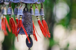 Feng Shui Chinese Bell and Coin being blown royalty free stock photo