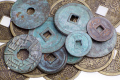 Feng Shui coins. Macro of chinese ancient coins on white background royalty free stock photo