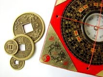 Feng shui compass and coins. Feng shui compass (Luopan) and chinese coins royalty free stock images
