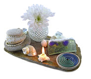 Feng shui composition with soap. Soap in foam with candle and white flowers isolated stock photos