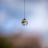 Feng shui crystal. Hanging at home royalty free stock image