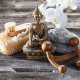 Feng shui decor for pampering nail and body. Spa beauty treatment concept - cleansing, exfoliation and massage tools with spiritual symbol such as Buddha on old Stock Image