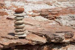 Feng shui equilibre with earth toned tilled stones. On a red flat rock Stock Image