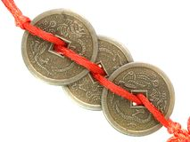 Feng Shui lucky coins. Fengshui lucky coins on red cord, isolated on white Royalty Free Stock Photo