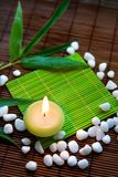 Feng-shui note. Background with stones, candle and bamboo leaves stock images