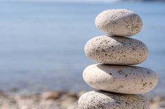 Feng shui stones. Round stones for meditation laying on seacoast Stock Image