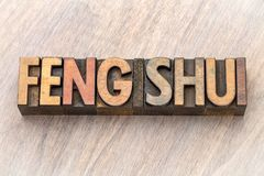 Feng shui word abstract in wood type. Feng shui word abstract in vintage letterpress wood type blocks stock image