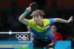 Feng Tianwey playing table tennis at the Olympic Games in Rio 2016. Feng Tianwey at the Olympic Games in Rio 2016 Royalty Free Stock Photography