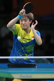 Feng Tianwey playing table tennis at the Olympic Games in Rio 2016. Stock Image