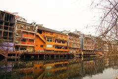 Fenghuang ancient town,china. Fenghuang (Phoenix in English), small touristic town in Hunan province in China. Picturesque old buildings reflection in water Royalty Free Stock Photos