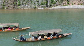 FENGHUANG - April 13:Wooden boats with tourists at Fenghuang. FENGHUANG - April 13:Wooden boats with tourists at Fenghuang ancient town on April 13, 2015 in Royalty Free Stock Images