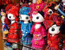 Fenghuang, China - May 15, 2017: Handmade dolls are sold as souvenirs from China in national clothes stock image